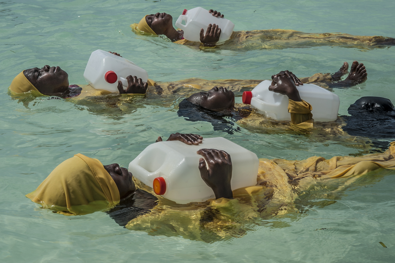 Kijini Primary School students learn to float, swim and perform rescues on Tuesday, October 25, 2016 in the Indian Ocean off of Mnyuni, Zanzibar.